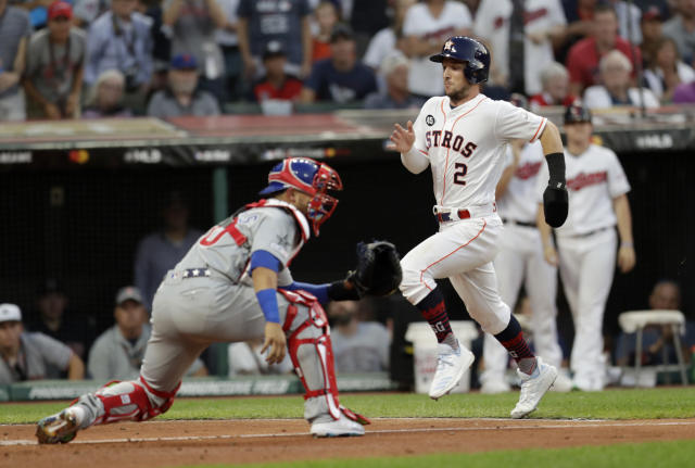 American League's Alex Bregman (2), of the Houston Astros, scores past National League catcher Willson Contreras, of the Chicago Cubs, during the second inning of the MLB baseball All-Star Game, Tuesday, July 9, 2019, in Cleveland. (AP Photo/Tony Dejak)