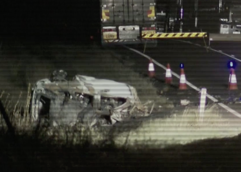 Photo of the scene of a crash that killed four children and their mother.