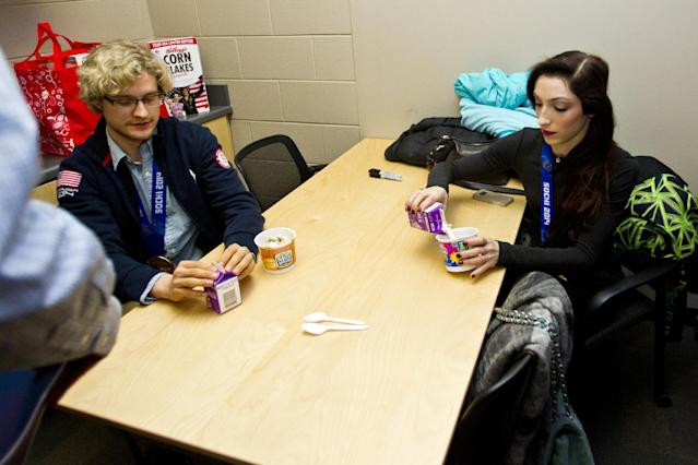 U.S. gold medalist Olympic ice dancing duo Meryl Davis, right, and Charlie White have a breakfast of Kellogg's cereal with milk, before Kellogg's National Breakfast Week event at Salem High School, Friday, March 7, 2014, in Canton, Mich. (Tony Ding/AP Images for Kellogg's)