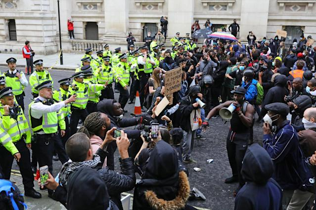 Police clash with protesters during a Black Lives Matter protest rally in Westminster, London, on Sunday. (PA)
