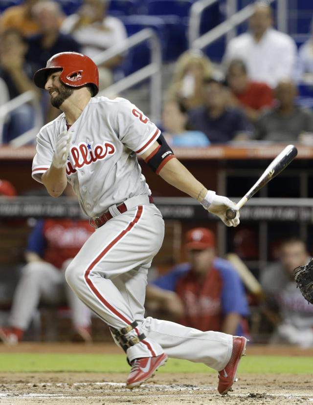 Philadelphia Phillies' Kevin Frandsen grounds out to score Chase Utley in the first inning of a baseball game against the Miami Marlins,Tuesday, Sept. 24, 2013, in Miami. (AP Photo/Lynne Sladky)