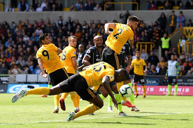 "<a class=""link rapid-noclick-resp"" href=""/soccer/teams/wolverhampton-wanderers/"" data-ylk=""slk:Wolverhampton Wanderers"">Wolverhampton Wanderers</a> defender Willy Boly scored Wolves' opener against Manchester City with his arm. (Getty)"