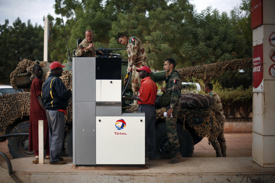 French soldiers fill up their tank at a local petrol station in Sevare, some 620 kilometers (385 miles) north of Mali's capital Bamako, Friday, Jan. 25, 2013. The French currently have some 2,400 forces in the country and have said that they will stay as long as needed in Mali, a former French colony. However, they have called for African nations to take the lead in fortifying the Malian army's efforts. (AP Photo/Jerome Delay)