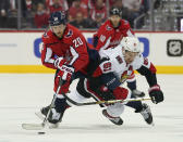 Washington Capitals center Lars Eller (20) and Ottawa Senators right wing Mark Stone (61) chase the puck during the first period of an NHL hockey game Tuesday, Feb. 27, 2018, in Washington. (AP Photo/Pablo Martinez Monsivais)
