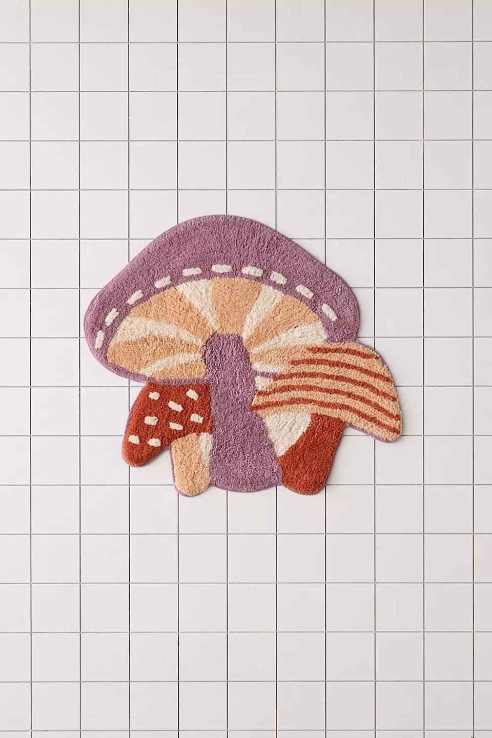 """<h2>Urban Outfitters Tufted Mushroom Bath Mat</h2><br>Funghi are, by nature, funky — so, we can definitely get down with this groovy tufted floor topper.<br><br><em>Shop <strong><a href=""""https://www.urbanoutfitters.com/shop/mushroom-tufted-bath-mat"""" rel=""""nofollow noopener"""" target=""""_blank"""" data-ylk=""""slk:Urban Outfitters"""" class=""""link rapid-noclick-resp"""">Urban Outfitters</a></strong></em><br><br><strong>Urban Outfitters</strong> Mushroom Tufted Bath Mat, $, available at <a href=""""https://go.skimresources.com/?id=30283X879131&url=https%3A%2F%2Fwww.urbanoutfitters.com%2Fshop%2Fmushroom-tufted-bath-mat"""" rel=""""nofollow noopener"""" target=""""_blank"""" data-ylk=""""slk:Urban Outfitters"""" class=""""link rapid-noclick-resp"""">Urban Outfitters</a>"""