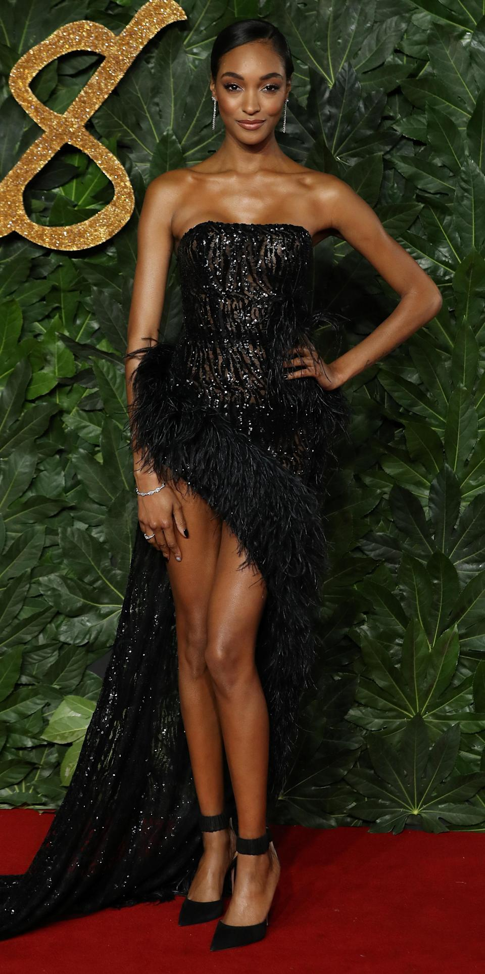 <p>Three's a trend: model Jourdan Dunn followed Cindy Crawford's exmaple in a feathered thigh-high split dress on the red carpet. To accessorise the look, the model wore Lark & Berry's Knot earrings, Aerides Diamond Dress ring and Wave Diamond bracelet – all from the brand's Atelier collection. <em>[Photo: Getty]</em> </p>