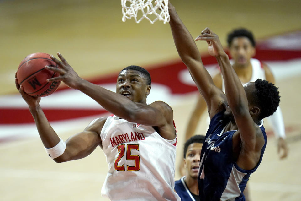 Maryland forward Jairus Hamilton (25) goes up for a shot against St. Peter's forward KC Ndefo during the first half of an NCAA college basketball game, Friday, Dec. 4, 2020, in College Park, Md. (AP Photo/Julio Cortez)