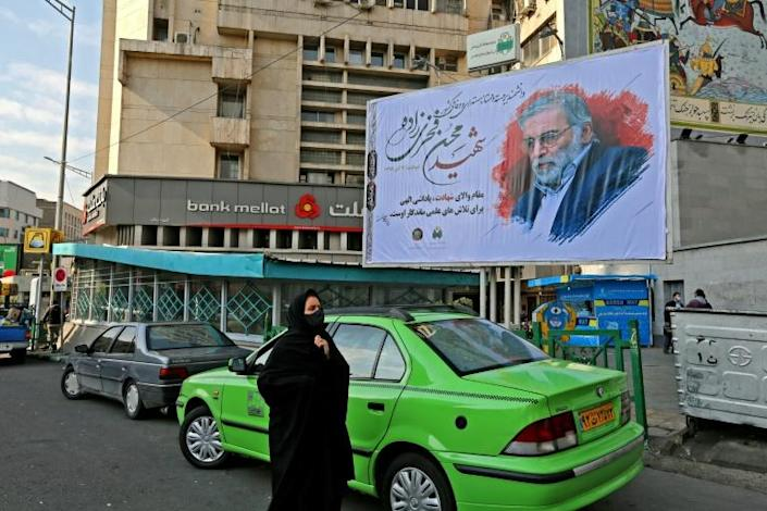 """Fakhrizadeh, shown here on a billboard in the capital, did not have a high profile before he was killed, but is now being celebrated as a top """"martyr"""" by the Islamic republic"""