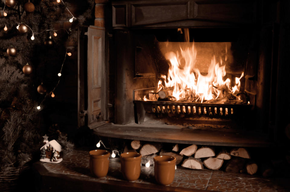Candle centrepieces burning dining tables, flames setting fire to Christmas decorations and wax spilled on carpets are common holiday hazards. Photo: Getty Images