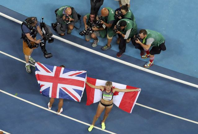2016 Rio Olympics - Athletics - Final - Women's Heptathlon 800m - Olympic Stadium - Rio de Janeiro, Brazil - 13/08/2016. Jessica Ennis-Hill (GBR) of Britain and Brianne Theisen-Eaton (CAN) of Canada pose for photographers. REUTERS/Fabrizio Bensch FOR EDITORIAL USE ONLY. NOT FOR SALE FOR MARKETING OR ADVERTISING CAMPAIGNS.