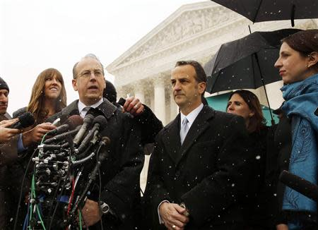 Attorney Paul Clement speaks to the press next to attorney Dave Cortman on the steps of the Supreme Court in Washington