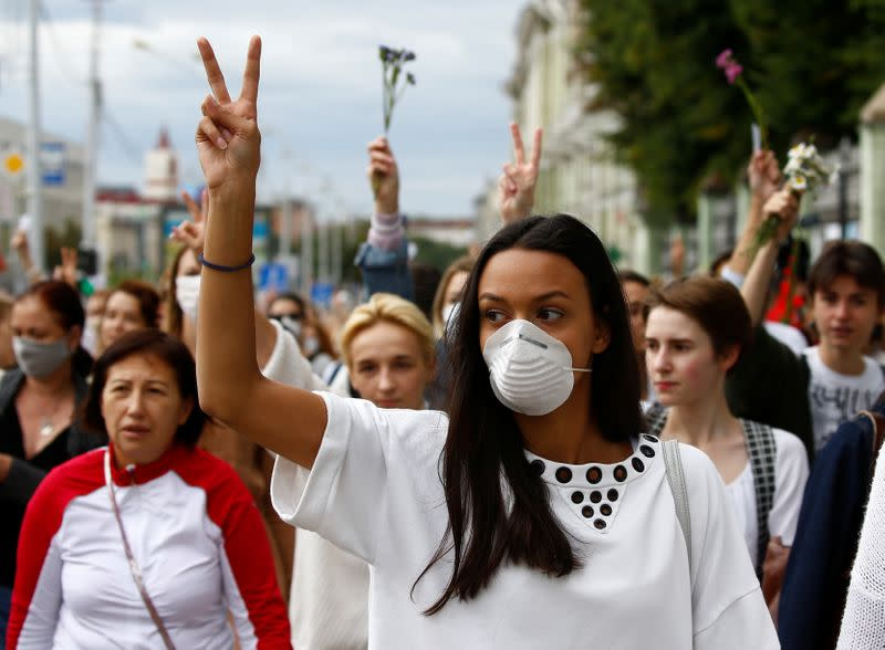 Women take part in a demonstration against police violence in Minsk