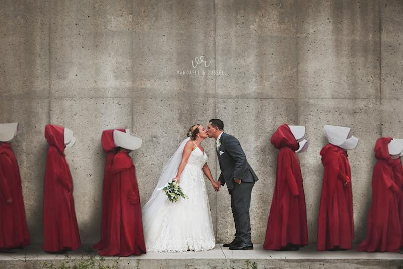 A wedding portrait shot at the location for Gilead's gruesome Wall — with women in red robes digitally added — has sparked controversy. (Photo: Courtesy of Van Daele & Russell)