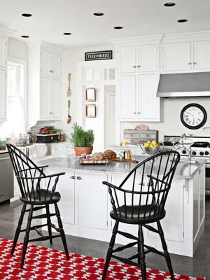 """<div class=""""caption-credit""""> Photo by: Max Kim-Bee</div><div class=""""caption-title"""">A Dash of Color</div>Windsor stools and a red-patterned rug sit in front of the kitchen's island in this <a href=""""http://www.countryliving.com/homes/house-tours/artful-approach-to-decorating-0311?link=emb&dom=yah_life&src=syn&con=blog_countryliving&mag=clg"""" target=""""_blank"""">Pennsylvania home</a>. Boat hardware takes a supporting role as kitchen cabinet latches. <br> <b><br> Plus: <br> <a target=""""_blank"""" href=""""http://www.countryliving.com/homes/decor-ideas/kitchen-designs?link=rel&dom=yah_life&src=syn&con=blog_countryliving&mag=clg"""">The Ultimate Guide to Kitchen Decorating »</a> <br> <a target=""""_blank"""" href=""""http://www.countryliving.com/homes/decor-ideas/bedroom-designs-gallery?link=rel&dom=yah_life&src=syn&con=blog_countryliving&mag=clg"""">100+ Bedroom Design Ideas You'll Love »</a></b> <br>"""