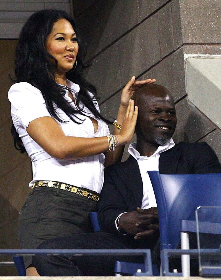 "Kimora Lee Simmons massages her main squeeze Djimon Hounsou while watching a match from their private box. Juan Soliz/<a href=""http://www.pacificcoastnews.com/"" target=""new"">PacificCoastNews.com</a> - September 3, 2008"