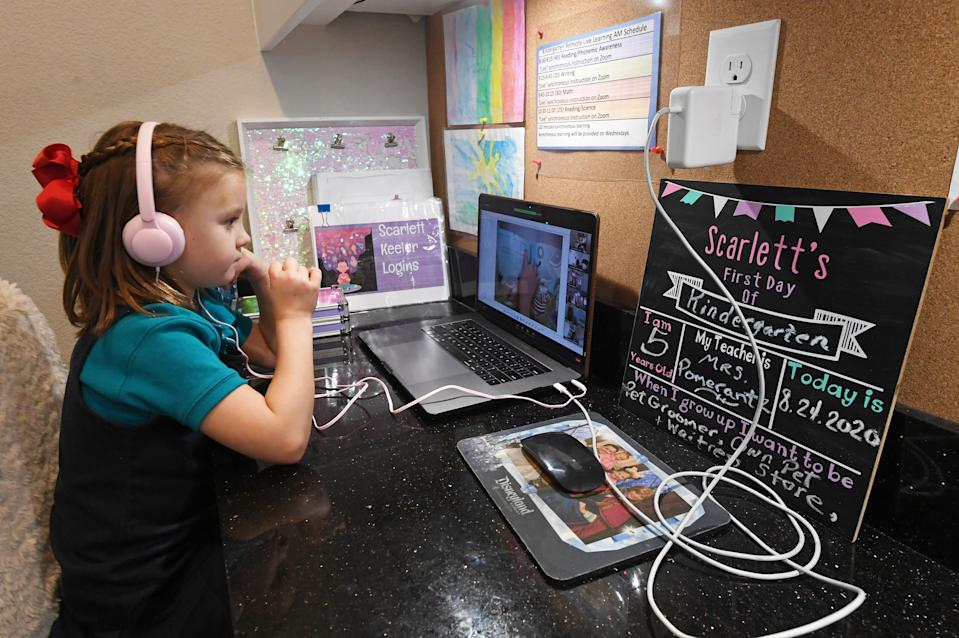 Doral Academy Red Rock Elementary School kindergartener Scarlett Keeler, 5, takes an online reading and science class on her first day of distance learning amid the spread of the coronavirus on August 24, 2020, in Las Vegas, Nevada. (Photo by Ethan Miller/Getty Images)