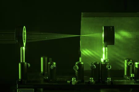 A cloaking device using four lenses developed by University of Rochester physics professor John Howell and graduate student Joseph Choi is demonstrated in Rochester, New York in this September 11, 2014 University of Rochester handout photo. REUTERS/J. Adam Fenster/University of Rochester/Handout via Reuters