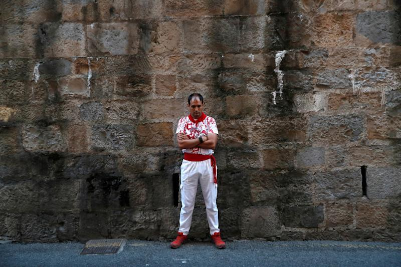 A runner waits for start of the running of the bulls during the San Fermin festival in Pamplona, Spain July 11, 2019. (Photo: Susana Vera/Reuters)