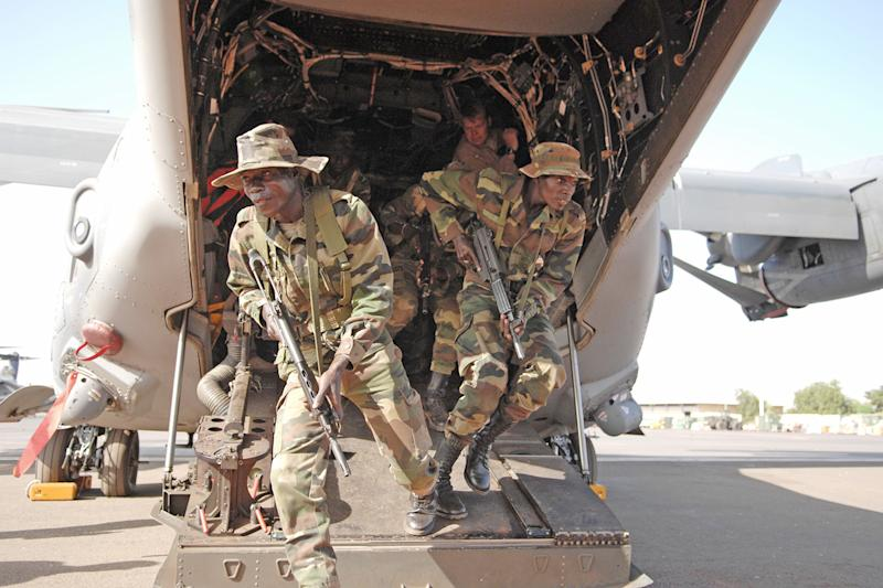 Senegalese soldiers exit an Air Force Special Operations Command CV-22 Osprey during mission rehearsals as part of exercise Flintlock in Bamako, Mali.