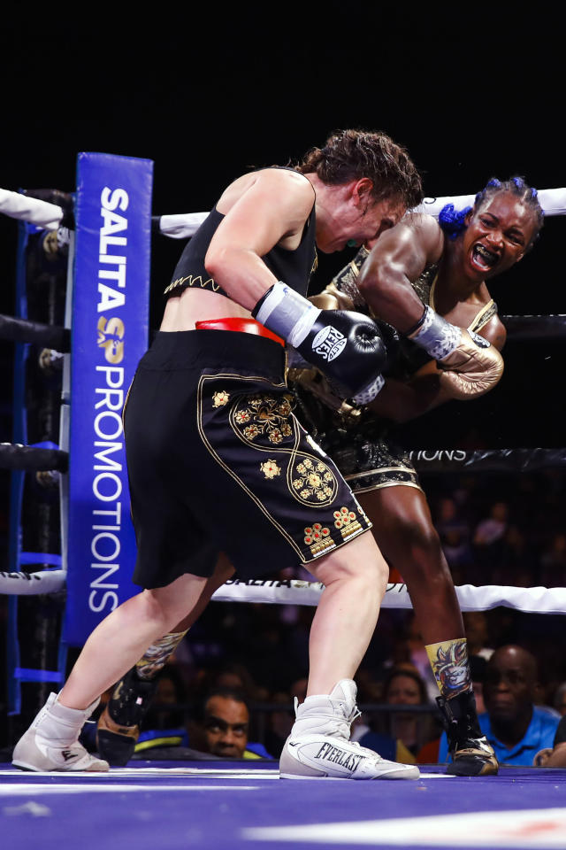 Claressa Shields, right, fights Ivana Habazin during the seventh round of a women's 154-pound title boxing bout in Atlantic City, N.J., Friday, Jan. 10, 2020. (AP Photo/Matt Rourke)