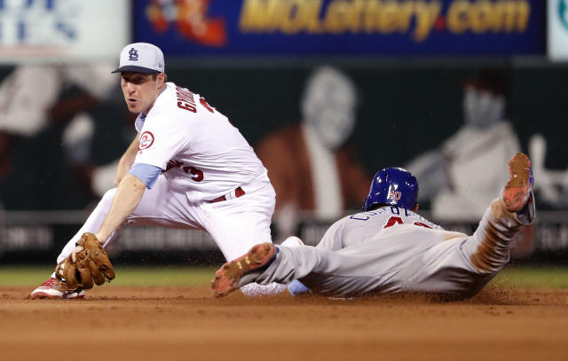 St. Louis Cardinals second baseman Jedd Gyorko, left, prepares to tag out Chicago Cubs' Willson Contreras on a failed stolen base attempt during the sixth inning of a baseball game, Sunday, June 17, 2018, in St. Louis. (AP Photo/Jeff Roberson)