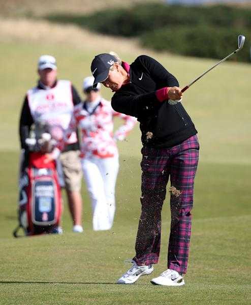 Norway's Suzann Pettersenplays her shot on the 15th fairway during the third round of the Women's British Open golf championship on the Old Course at St Andrews, Scotland, Sunday Aug. 4, 2013. Play in the third round was suspended on Saturday due to high winds (AP Photo/Scott Heppell)