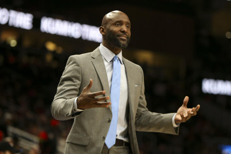 Atlanta Hawks head coach Lloyd Pierce reacts to a referee in the first half of an NBA basketball game against the Indiana Pacers, Friday, Dec. 13, 2019, in Atlanta. (AP Photo/Brett Davis)