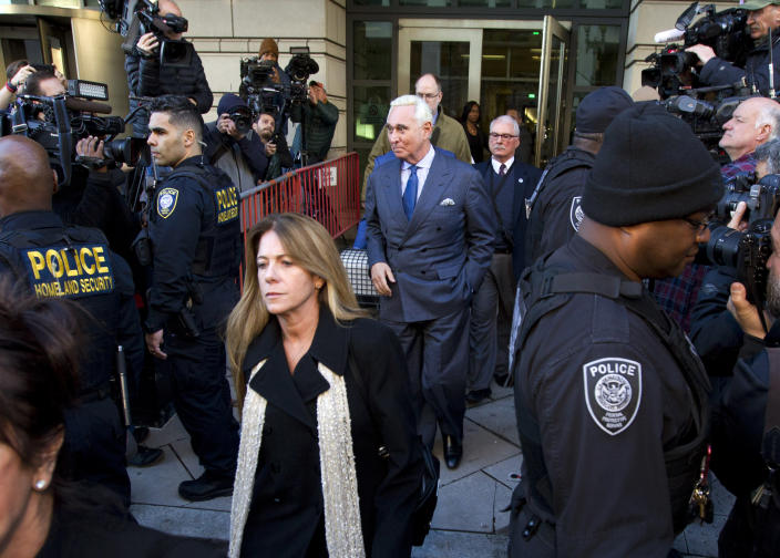 Former campaign adviser for President Donald Trump, Roger Stone leaves the federal court in Washington, Thursday, Feb. 21, 2019, as his daughter Adria, Stone walks in front of him. (AP Photo/Jose Luis Magana)