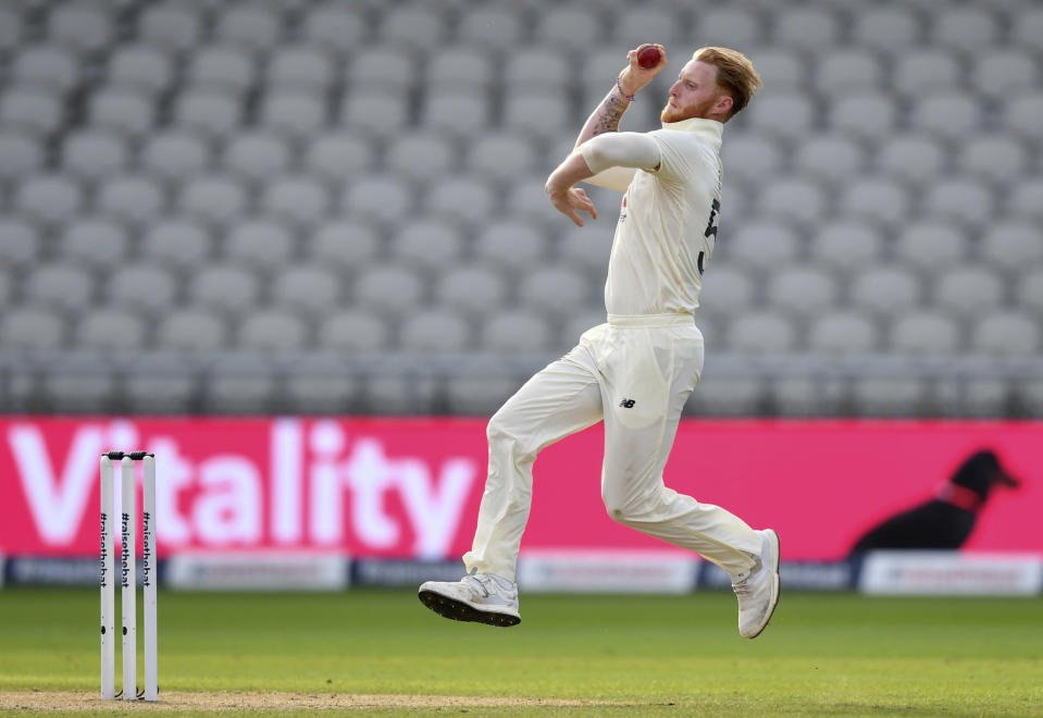 England's Ben Stokes bowls a delivery during the third day of the first cricket Test match between England and Pakistan at Old Trafford in Manchester, England, Friday, Aug. 7, 2020. (Dan Mullan/Pool via AP)