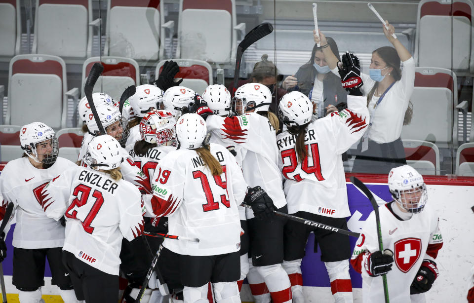 Switzerland celebrate after defeating Russian Olympic Committee during overtime quarterfinal IIHF Women's World Championship hockey game in Calgary, Alta., Saturday, Aug. 28, 2021. (Jeff McIntosh/The Canadian Press via AP)