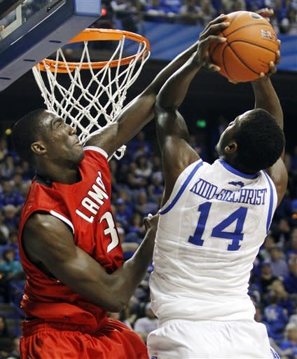 Lamar's Osas Ebomwonyi, left, fouls Kentucky's Michael Kidd-Gilchrist (14) during the second half of an NCAA college basketball game in Lexington, Ky., Wednesday, Dec. 28, 2011. Kentucky won 86-64. (AP Photo/James Crisp)