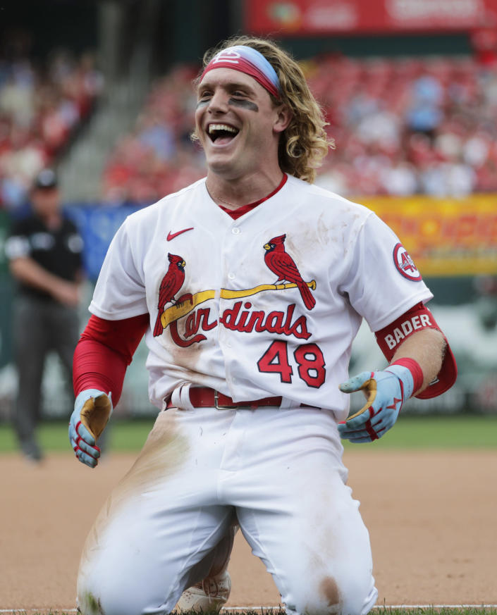St. Louis Cardinals' Harrison Bader (48) celebrates after beating out an infield RBI-single in the seventh inning of a baseball game against the San Francisco Giants, Sunday, July 18, 2021, in St. Louis. (AP Photo/Tom Gannam)