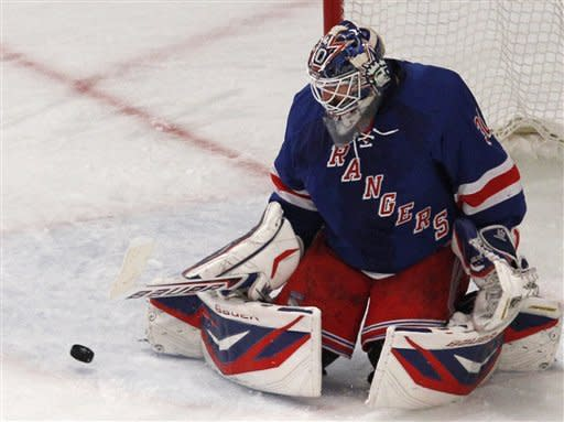 \New York Rangers goalie Henrik Lundqvist (30) makes a save against the Washington Capitals in the second period of Game 7 of a second-round NHL hockey Stanley Cup playoff series at Madison Square Garden in New York, Saturday, May 12, 2012. (AP Photo/Kathy Willens)