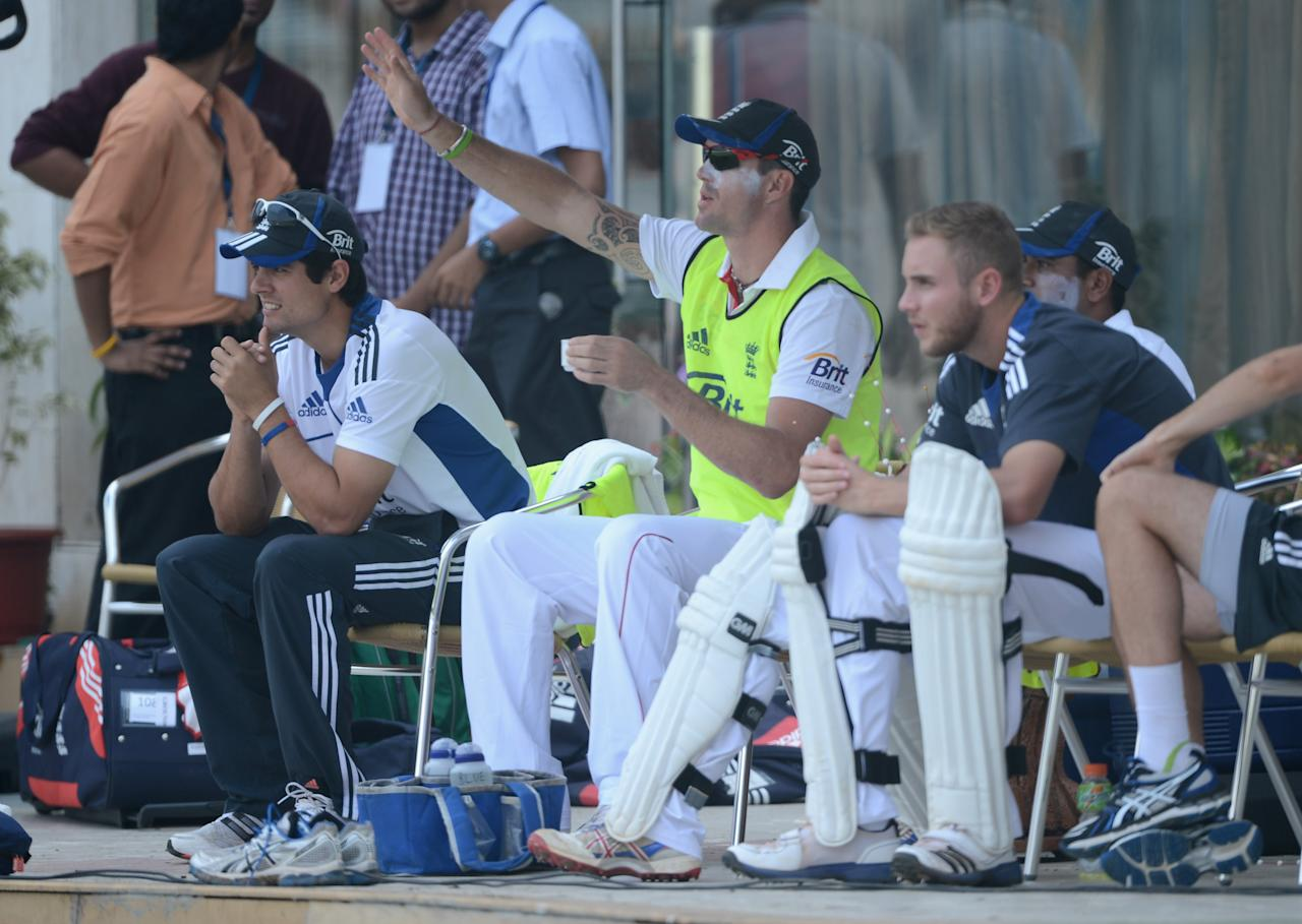 MUMBAI, INDIA - NOVEMBER 03:  Kevin Pietersen of England speaks with captain Alastair Cook and Stuart Broad during day one of the tour match between Mumbai A and England at The Dr D.Y. Palit Sports Stadium on November 3, 2012 in Mumbai, India.  (Photo by Gareth Copley/Getty Images)