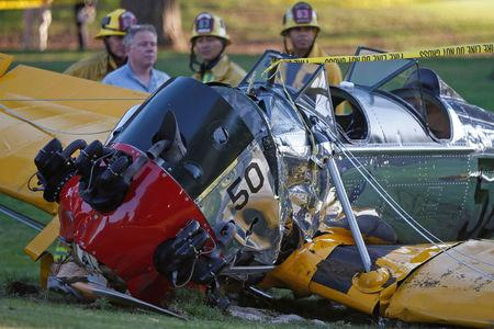 FILE PHOTO: An airplane sits on the ground after crash landing at Penmar Golf Course in Venice, Los Angeles California March 5, 2015.  REUTERS/Lucy Nicholson/File Photo