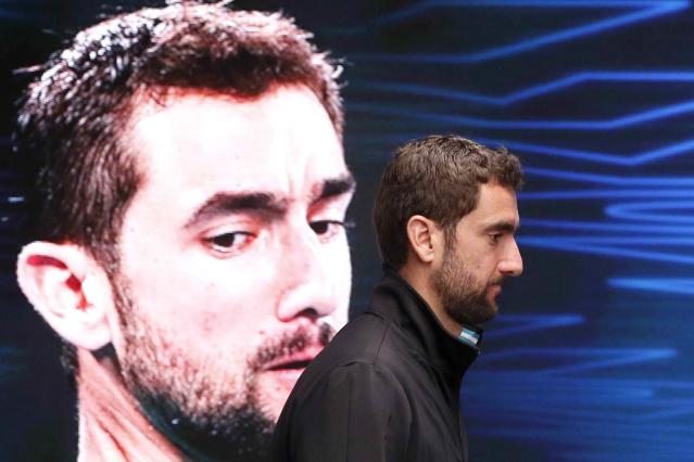 Tennis - Australian Open - Men's singles final - Rod Laver Arena, Melbourne, Australia, January 29, 2018. Croatia's Marin Cilic arrives for a press conference after losing the final against Switzerland's Roger Federer. REUTERS/Edgar Su