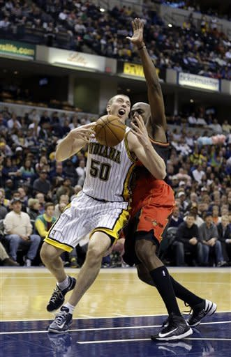 Indiana Pacers' Tyler Hansbrough (50) goes to the basket against Atlanta Hawks' Anthony Tolliver (4) during the second half of an NBA basketball game Monday, March 25, 2013, in Indianapolis. The Pacers defeated the Hawks 100-94. (AP Photo/Darron Cummings)
