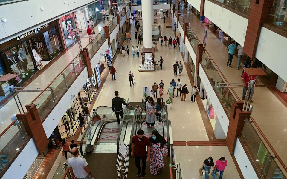 People visit Select City Mall after authorities eased a lockdown imposed as a preventive measure against coronavirus in New Delhi - PRAKASH SINGH/AFP