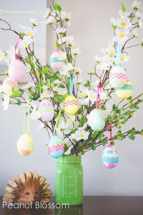 """<p>Here's one craft that's easy enough to involve the littlest ones in your family. Simply fill a Mason jar with foraged branches, then decorate with store-bought Easter accessories.</p><p><strong>Get the tutorial at <a href=""""https://www.peanutblossom.com/blog/2015/03/easter-egg-tree.html/"""" rel=""""nofollow noopener"""" target=""""_blank"""" data-ylk=""""slk:Peanut Blossom"""" class=""""link rapid-noclick-resp"""">Peanut Blossom</a>.</strong></p><p><a class=""""link rapid-noclick-resp"""" href=""""https://www.amazon.com/Supla-Colors-Fabric-Embellish-Wedding/dp/B07BDG8KXB/ref=dp_prsubs_1?tag=syn-yahoo-20&ascsubtag=%5Bartid%7C10050.g.26498744%5Bsrc%7Cyahoo-us"""" rel=""""nofollow noopener"""" target=""""_blank"""" data-ylk=""""slk:SHOP RIBBONS""""><b>SHOP RIBBONS</b> </a></p>"""