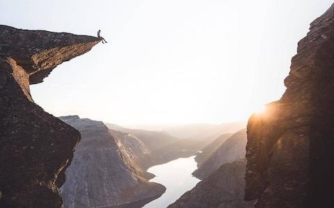 An Instagram post of the Trolltunga outcropping in Norway, which has seen a sharp surge in visitors in the last decade - Credit: Instagram/@lensbible
