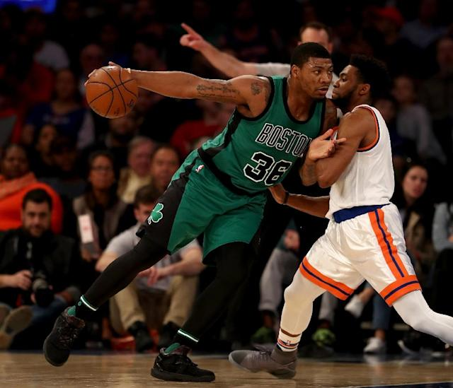 Marcus Smart (L) of the Boston Celtics drives as Chasson Randle of the New York Knicks defends on April 2, 2017 (AFP Photo/ELSA)