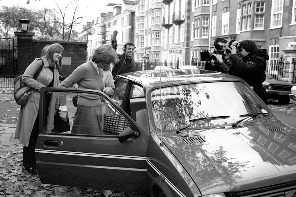 Lady Diana Spencer, surrounded by the media, leaving her Earl's Court flat in her bright new mini metro en route to her job as a teacher at a kindergarten in nearby Pimlico.   (Photo by PA Images via Getty Images)