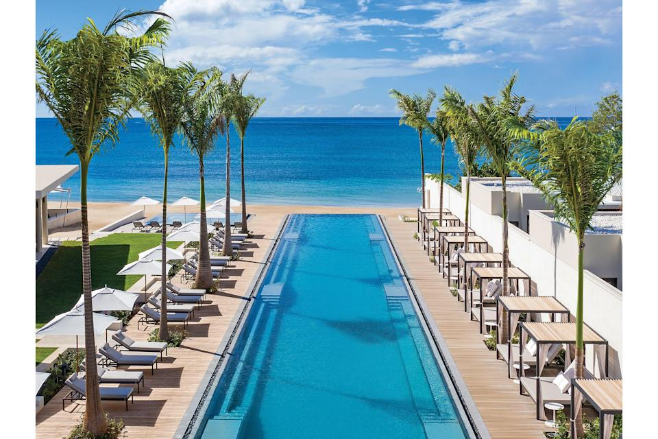 "<p><b>St. George's Grenada</b></p> <p>Yes, it begins at that pool. Stretching from the breezy, serenely modernist lobby past pale cabanas and lounges 330 turquoise feet to the cerulean waters of Grand Anse Beach, it's a major design moment (not to mention the longest pool in the Caribbean). This minimalist magic permeates the entirety of this newly built resort that sets 43 suites and nine beachfront and hilltop villas with clean lines and restrained neutrals into the embrace of the gently sloping hillsides at its back. What better way to let this under-the-radar West Indian gem of an island dotted with fragrant spice trees, hidden waterfalls, and pale and pristine sands play the starring role it deserves? Rates start at $800; <a href=""https://www.silversandsgrenada.com/"" rel=""nofollow noopener"" target=""_blank"" data-ylk=""slk:silversandsgrenada.com"" class=""link rapid-noclick-resp"">silversandsgrenada.com</a>.</p>"