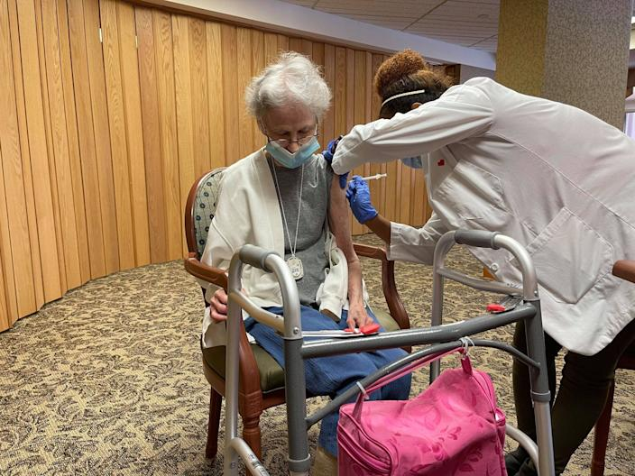 A Topeka Presbyterian Manor resident receives her first round of the Pfizer vaccine against COVID-19 on Saturday. Nursing homes, which have been hit particularly hard by the coronavirus, have priority status in receiving the vaccine.