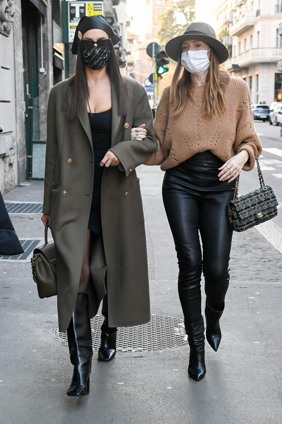 <p>Irina Shayk and pal Valentina Micchetti shop arm-in-arm in Milan on Monday. </p>