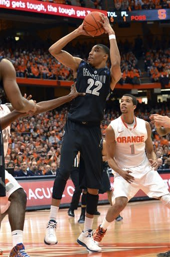 Georgetown's Otto Porter shoots against Syracuse during the first half in an NCAA college basketball game in Syracuse, N.Y., Saturday, Feb. 23, 2013. Georgetown won 57-46. (AP Photo/Kevin Rivoli)