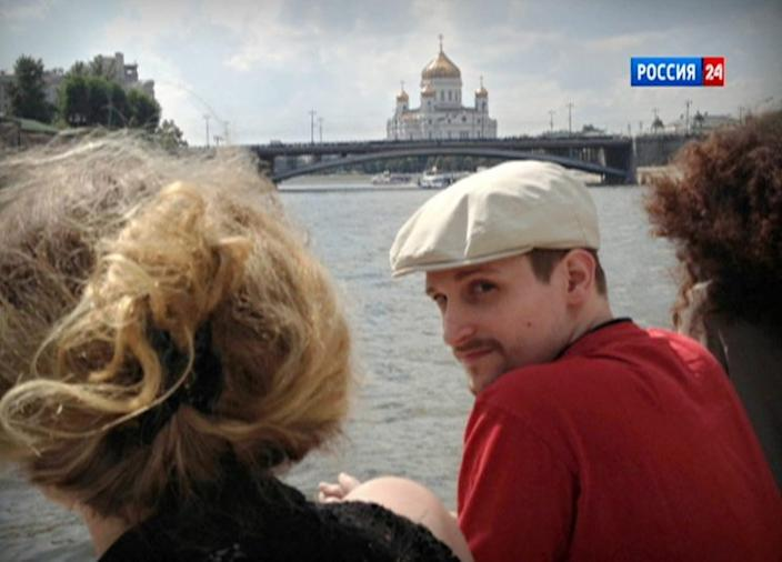 One of the only photos featuring Snowden in Moscow, taken in the fall of 2013 while he rode a boat passing the Cathedral of Christ the Savior. (Photo: LifeNews/Rossiya24)