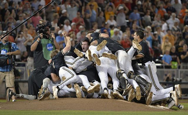 Vanderbilt players celebrate a 3-2 win over Virginia in the deciding game of the best-of-three NCAA baseball College World Series finals in Omaha, Neb., Wednesday, June 25, 2014. (AP Photo/Ted Kirk)