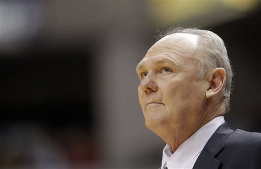 Denver Nuggets head coach George Karl looks at the scoreboard while playing the Indiana Pacers during the first half of an NBA basketball game in Indianapolis, Friday, Dec. 7, 2012. The Nuggets won 92-89.(AP Photo/AJ Mast)
