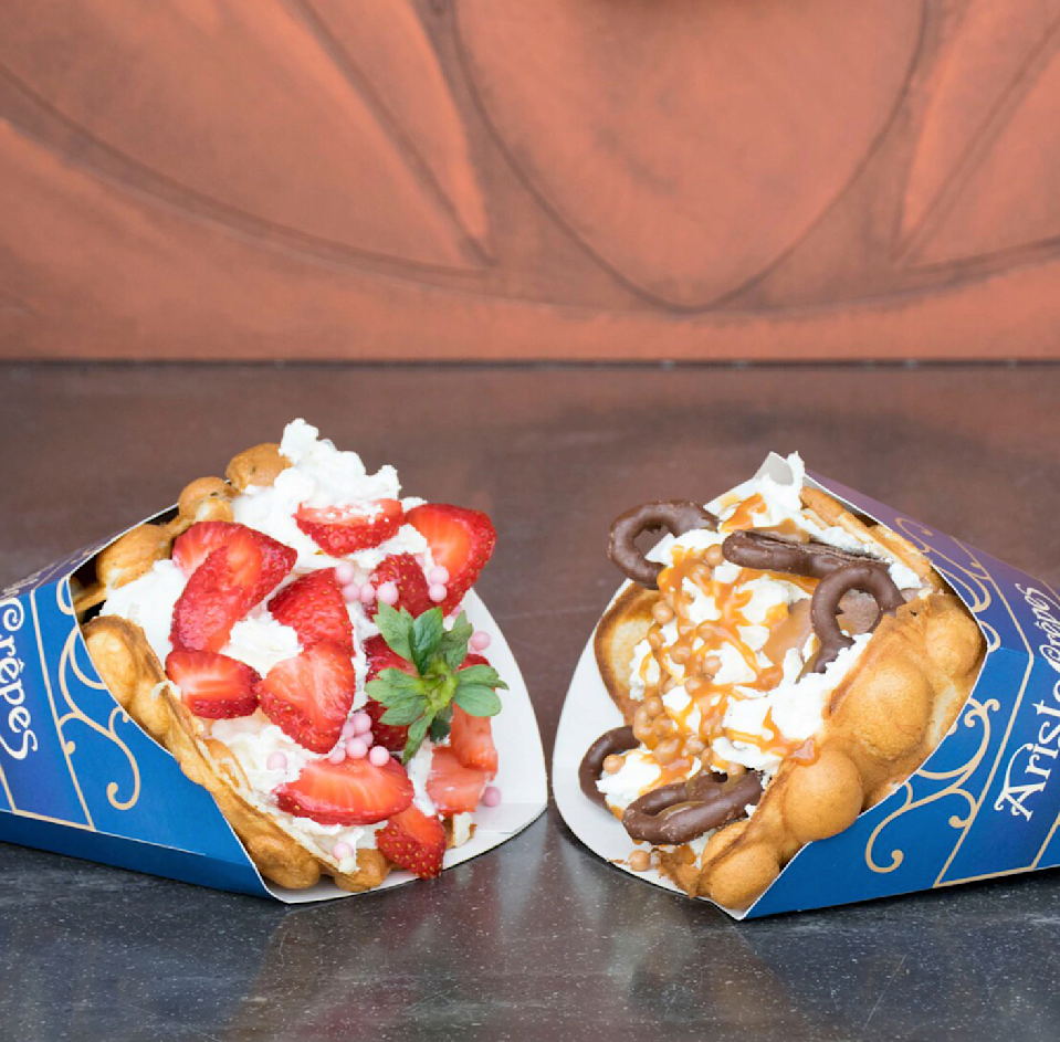 """<p>Even though bubble waffles were already a thing back in the, well, '50s, Disney made it popular again by having it at shops like <a href=""""https://www.disneysprings.com/dining/aristocrepes/"""" rel=""""nofollow noopener"""" target=""""_blank"""" data-ylk=""""slk:AristoCrepes"""" class=""""link rapid-noclick-resp"""">AristoCrepes</a> in Disney Springs. </p>"""